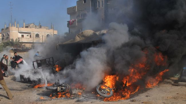 Israeli warplanes wage attacks on central, southern Gaza Strip