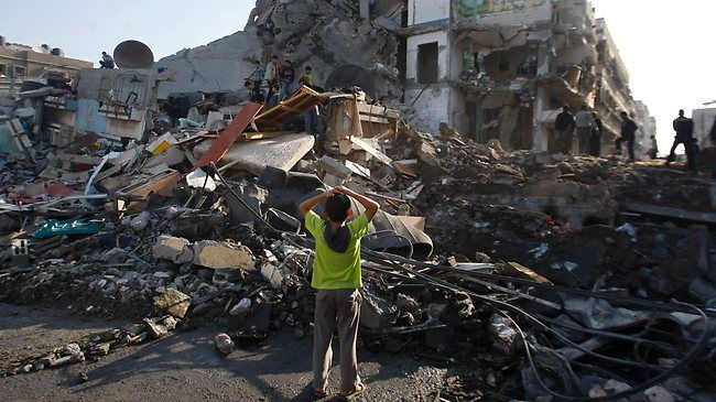 Palestinian children examined the rubble