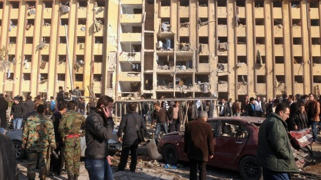 Car bomb attack kills 18 in Damascus suburb